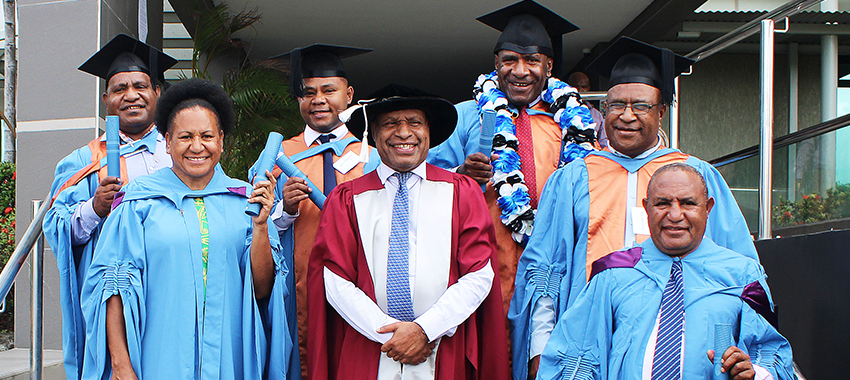 Four graduate with Masters